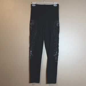 Bebe black legging with side lace panel